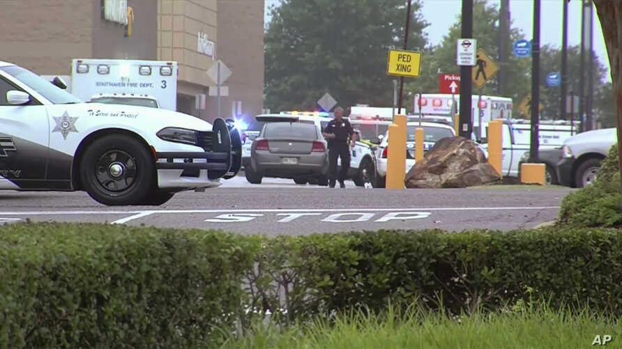 This still image provided by WATN-TV shows police and emergency personnel responding to a shooting at a Walmart in Southaven, Miss., on Tuesday, July 30, 2019. DeSoto County Sheriff Bill Rasco said that one person was killed and the suspect was shot…