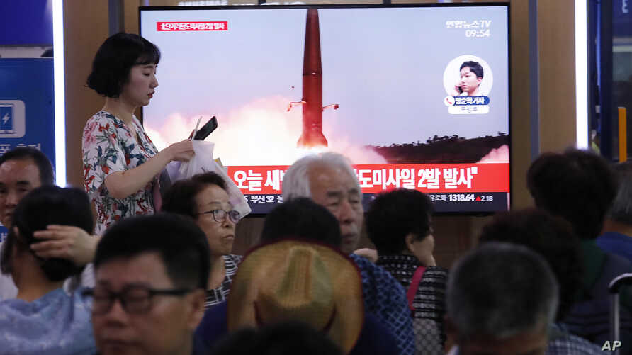 A TV at the Seoul Railway Station shows a file image of North Korea's missile launch during a news program, in Seoul, South Korea, Wednesday, July 31, 2019. North Korea fired two short-range ballistic missiles off its east coast Wednesday, South…