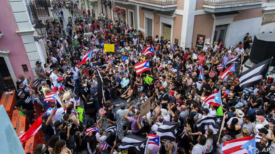 Demonstrators protest against Gov. Ricardo Rossello in San Juan, Puerto Rico, Sunday, July 21, 2019. Puerto Rico's embattled governor says he will not seek re-election but will not resign as the island's leader, though he will step down as head of…