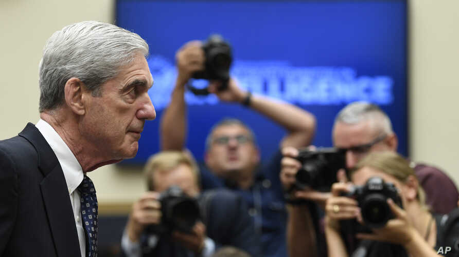 Former special counsel Robert Mueller returns to the witness table following a break in his testimony before the House Intelligence Committee on Capitol Hill, July 24, 2019.