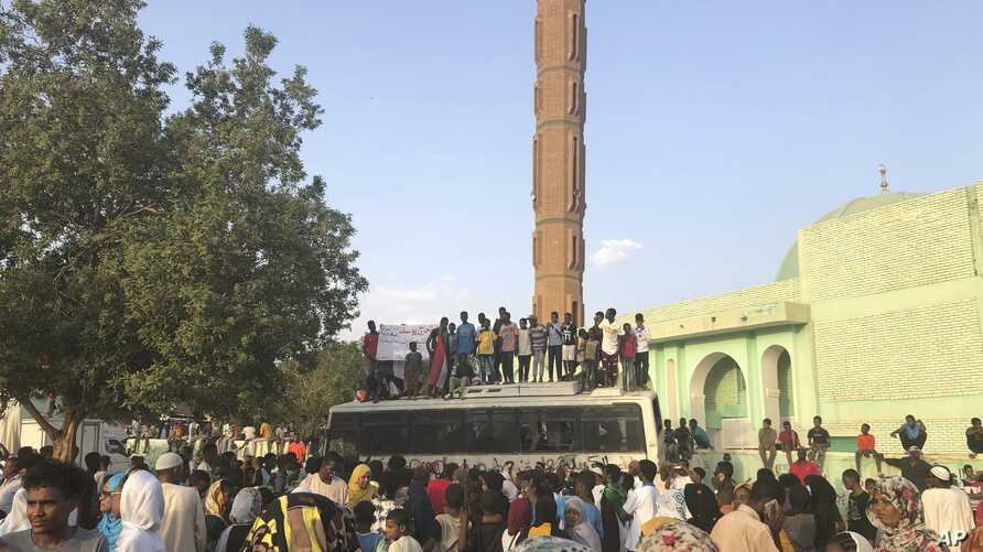 Sudanese people celebrate in the streets of Khartoum after ruling generals and protest leaders announced they have reached an agreement on the disputed issue of a new governing body on Friday, July 5, 2019.   The deal raised hopes it will end a…