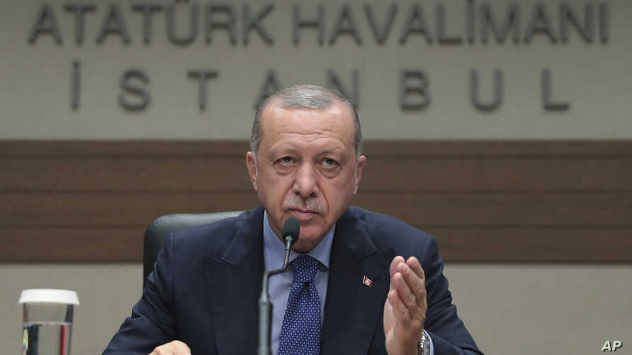 Turkey's President Recep Tayyip Erdogan speaks to reporters before leaving for Bosnia, in Istanbul, Monday, July 8, 2019. Erdogan says Russia's S-400 air defense missiles are currently being prepared to be flown to Turkey.  Erdogan would not however…
