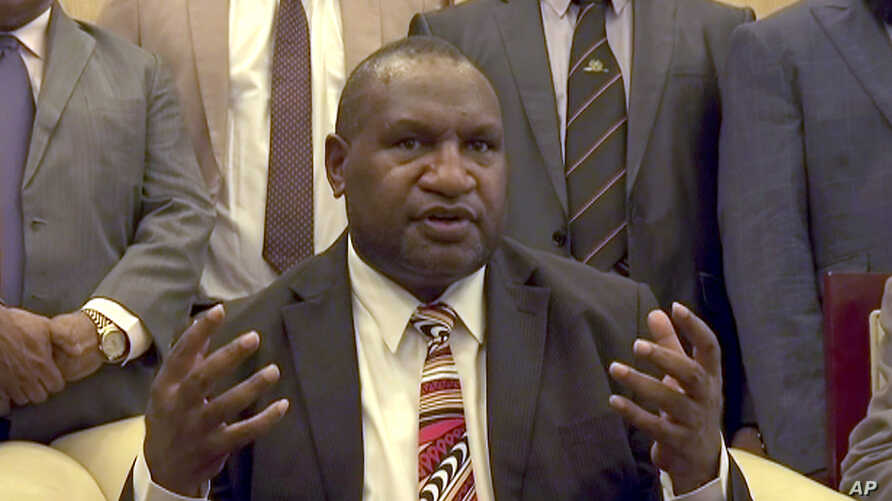 In this image made from video, Papua New Guinea's new Prime Minister James Marape speaks to media after being sworn in, Thursday, May 30, 2019, in Port Moresby, Papua New Guinea. The former finance minister Marape has been sworn in as the country's…