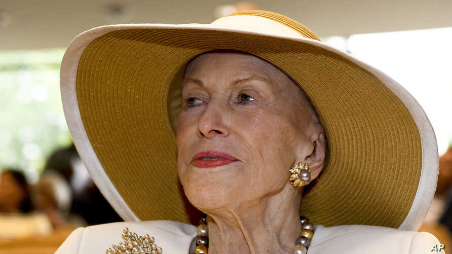 """In this Aug. 3, 2018 photo, MarylIn this Aug. 3, 2018 photo, Marylou Whitney is seen at the National Museum of Racing and Hall of Fame in Saratoga Springs, N.Y.  The """"Queen of Saratoga,"""" has died at 93.u Whitney is seen at the National Museum of Racing and Hall of Fame in Saratoga Springs, N.Y. Philanthropist, socialite and horse-racing enthusiast Marylou Whitney, known as the """"Queen of Saratoga,"""" has died at her…"""