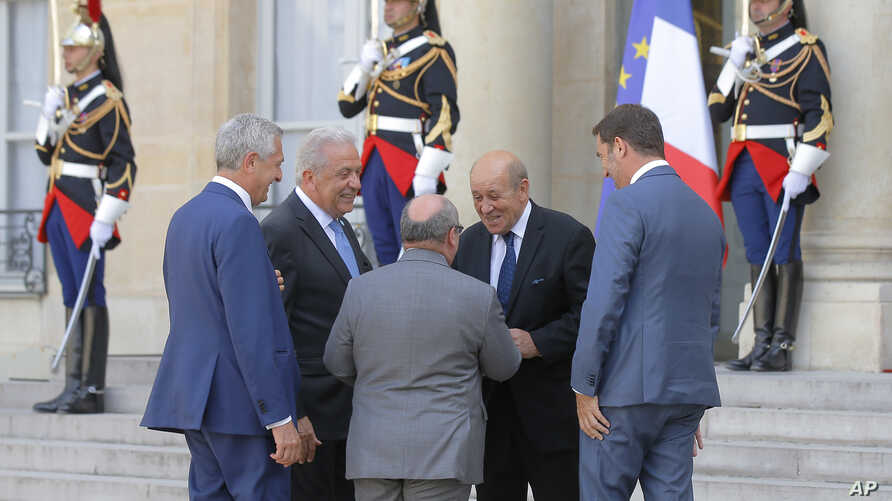 French FM Le Drian welcomes Director of the United Nations Migration Agency Antonio Manuel de Carvalho Ferreira Vitorino, center, French Interior Minister Christophe Castaner, right, United Nations High…