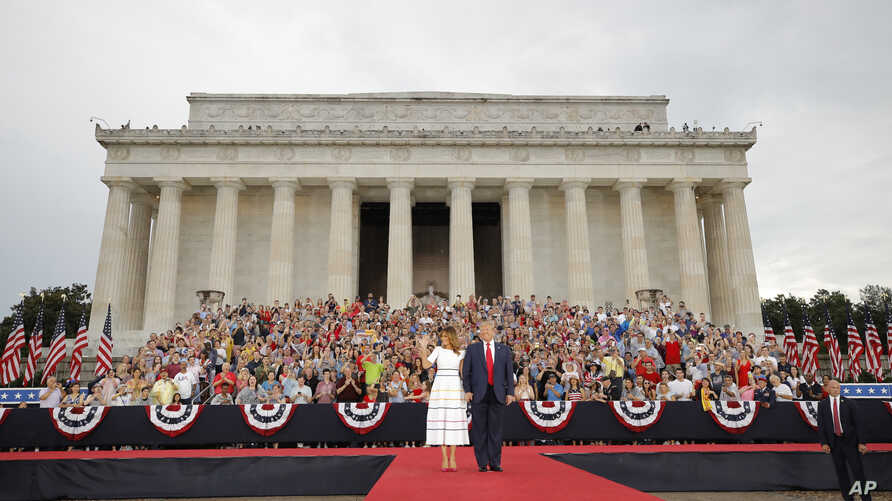 President Donald Trump and first lady Melania Trump arrive at an Independence Day celebration in front of the Lincoln Memorial, July 4, 2019, in Washington.