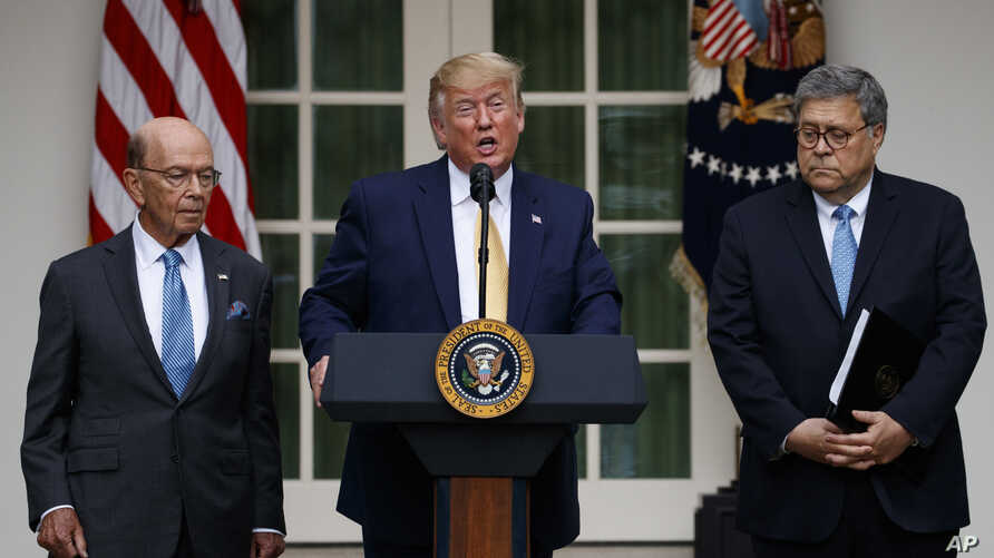 President Donald Trump, joined by Commerce Secretary Wilbur Ross, left, and Attorney General William Barr, speaks during an event about the census in the Rose Garden at the White House in Washington, July 11, 2019.