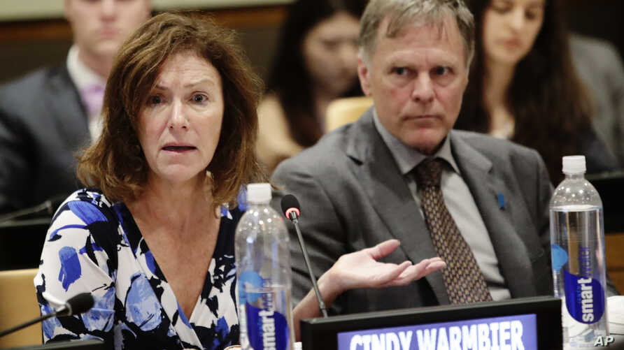 FILE - Fred Warmbier, right, listens as his wife, Cindy Warmbier, speaks of their son Otto Warmbier, an American who died in 2017 days after his release from captivity in North Korea, during a meeting at the United Nations headquarters, May 3, 2018.