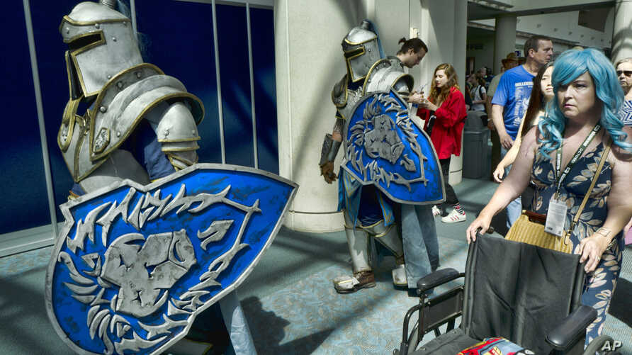 """FILE - In this Thursday, July 19, 2018, file photo, attendees Michael Mijerark, left, and Ryan Trent, center, dress as knights from """"Warcraft,"""" at Comic-Con International in San Diego. The four-day 2019 Comic-Con kicks off Wednesday, July 17, 2019,…"""