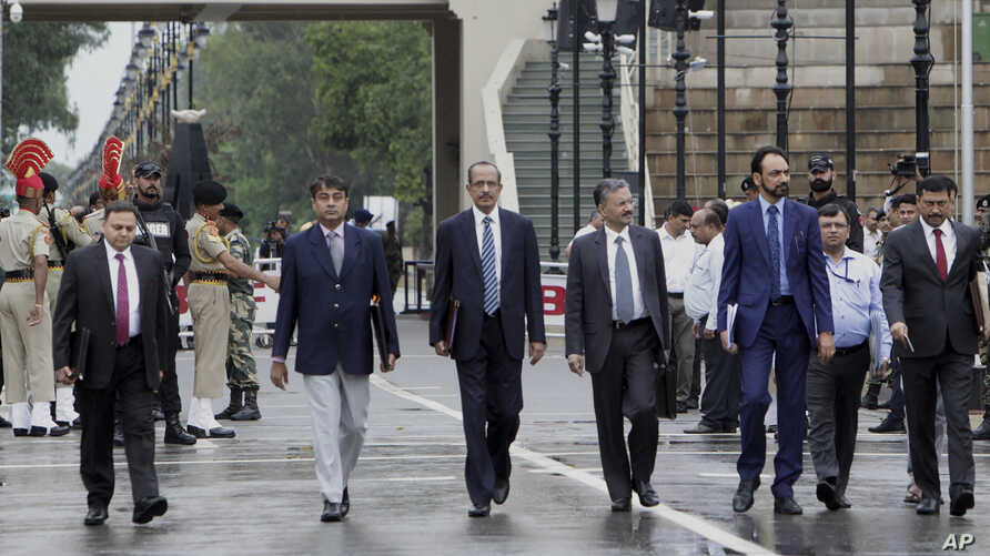 Indian officials from Ministry for External Affairs arrive after crossing the border for a meeting with Pakistani officials at Wagah border, near Lahore, Pakistan, Sunday, July 14, 2019. Pakistani and Indian officials met at Wahga joint border point…