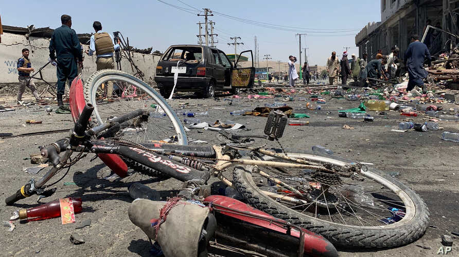 A damaged bicycle is seen at the site of a suicide attack in Kabul, Afghanistan, Thursday, July 25, 2019. Afghan police say a suicide bomber blew himself up Thursday in front of a bus carrying Ministry of Mines employees. (AP Photo/Rahmat Gul)