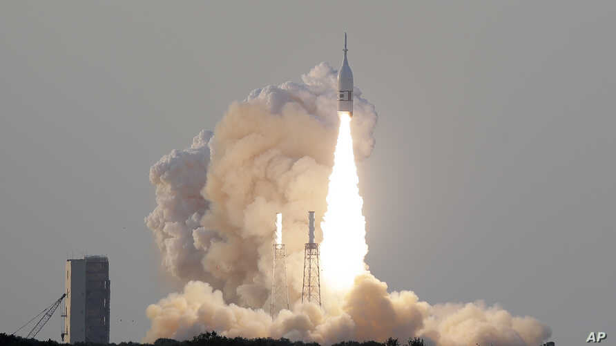 A NASA Orion spacecraft lifts off from pad 46 at the Cape Canaveral Air Force Station Tuesday, July 2, 2019, in Cape Canaveral, Fla. This launch is for a test of the capsule's launch abort system (LAS), which is a rocket-powered tower on top of the…