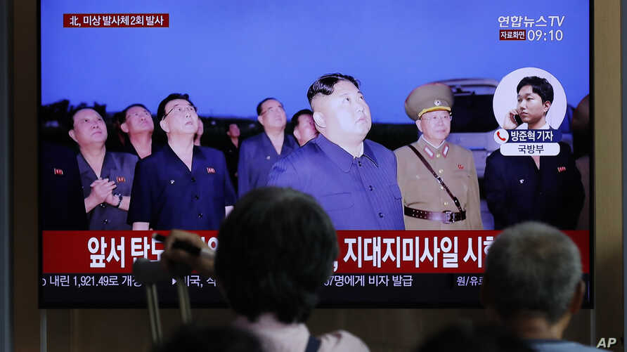 People watch a TV news program on North Korea's firing projectiles with a file image of North Korean leader Kim Jong Un at the Seoul Railway Station in Seoul, South Korea, Aug. 16, 2019.