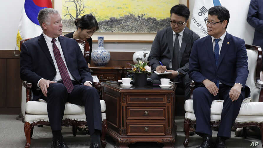 South Korean Unification Minister Kim Yeon Chul, right, and U.S. Special Representative for North Korea Stephen Biegun, left, talk during their meeting at a government complex in downtown Seoul, South Korea, Wednesday, Aug. 21, 2019. The United…