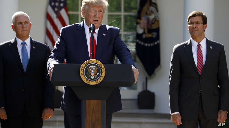 President Donald Trump, joined by Vice President Mike Pence, and Secretary of Defense Mark Esper, speaks during a ceremony to establish the U.S. Space Command in the Rose Garden of the White House in Washington, Thursday, Aug. 29, 2019. (AP Photo…