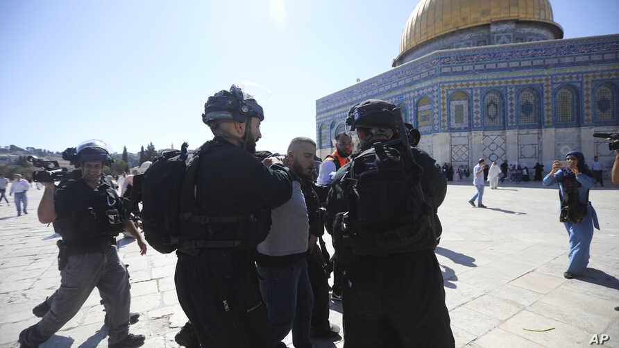 Israeli police arrests a Palestinian worshipper at al-Aqsa mosque compound in Jerusalem, Aug. 11, 2019.
