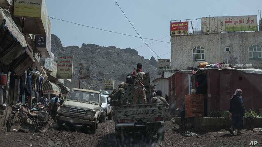 Fighters from a militia known as the Security Belt, that is funded and armed by the United Arab Emirates, head to the frontline in an area called Moreys, in Yemen's Dhale province, Aug. 5, 2019.