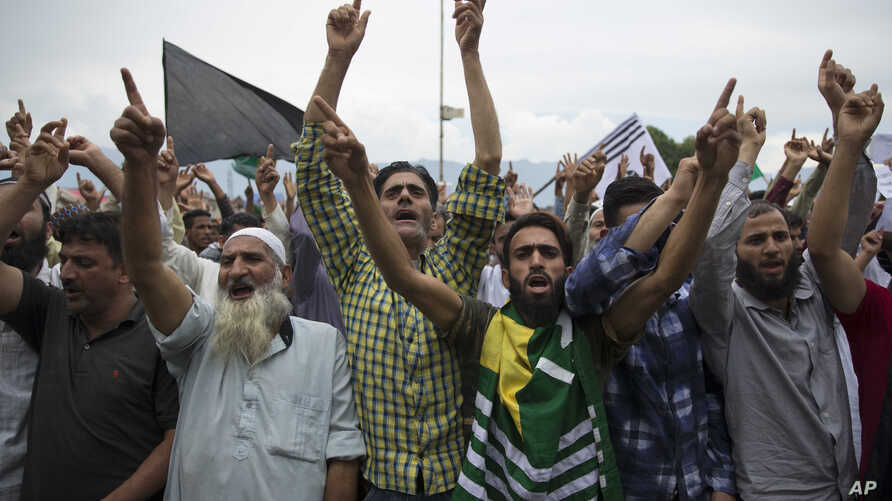 Kashmiri Muslims shout pro-freedom slogans during a demonstration after Friday prayers amid curfew like restrictions in Srinagar, India, Friday, Aug. 16, 2019. Hundreds of people have held a street protest in Indian-controlled Kashmir as India's…