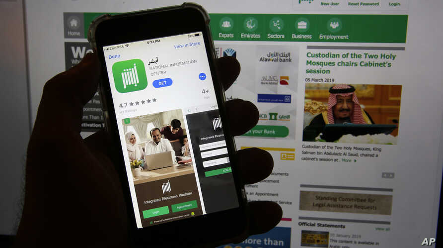 This photo shows the Absher App on a phone in Jiddah, Saudi Arabia, Thursday, March 7, 2019. The Saudi government app is mostly a way for people to pay traffic fines and complete other administrative tasks electronically. But one feature isn't…