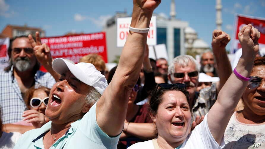 Supporters of Turkey's opposition Republican People's Party (CHP) chant slogans during a rally outside a court in Istanbul, where CHP Istanbul provincial chairwoman Canan Kaftancioglu appeared on trial, Thursday, July 18, 2019. Kaftancioglu is…