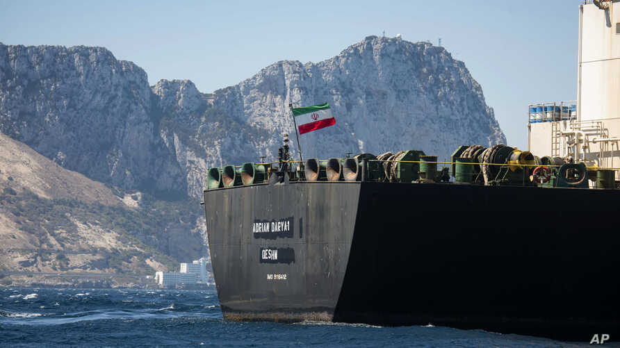 Renamed Adrian Aryra 1 super tanker hosting an Iranian flag sails in the waters in the British territory of Gibraltar, Sunday, Aug. 18, 2019. Authorities in Gibraltar on Sunday rejected the United States' latest request not to release a seized…