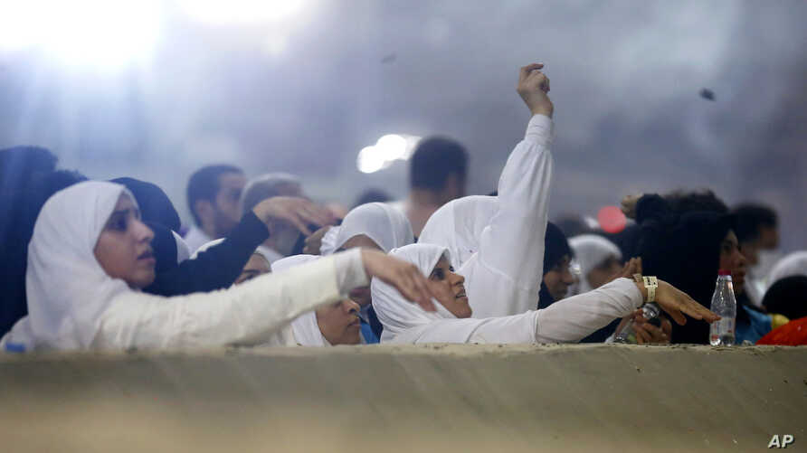 "Muslim pilgrims cast stones at a pillar symbolizing the stoning of Satan, in a ritual called ""Jamarat,"" the last rite of the annual hajj, on the first day of Eid al-Adha, in Mina near the holy city of Mecca, Saudi Arabia, Sunday, Aug. 11, 2019. The…"