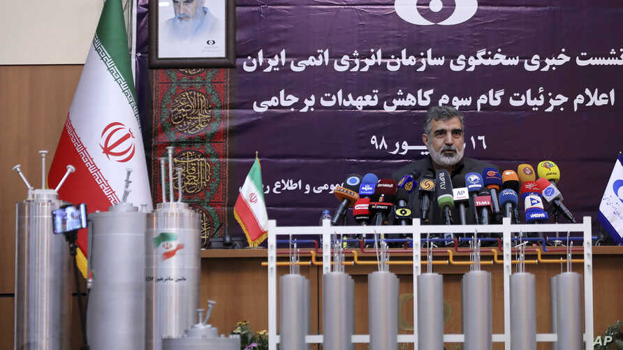 In this photo released by the Atomic Energy Organization of Iran, spokesman of the organization Behrouz Kamalvandi speaks in a news briefing as advanced centrifuges are displayed in front of him, in Tehran, Iran, Saturday, Sept. 7, 2019. Iran has…