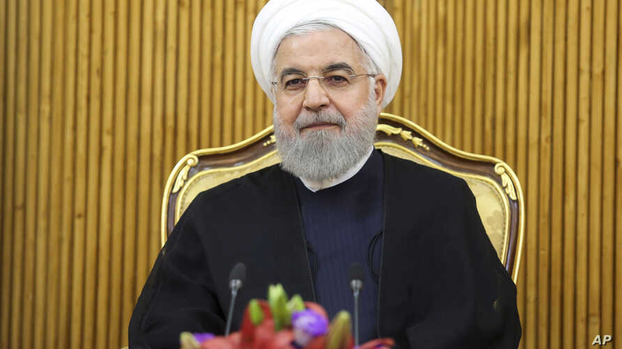 In this photo released by the official website of the office of the Iranian Presidency, President Hassan Rouhani sits at the Mehrabad airport pavilion before leaving Tehran, Iran, for New York to attend United Nations General Assembly, Monday, Sept…