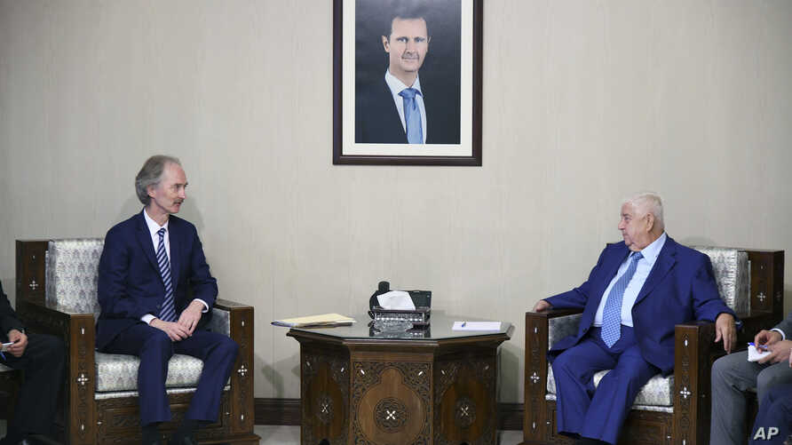 In this photo released by the Syrian official news agency SANA, the U.N.'s special envoy for Syria Geir Pedersen, left, meets with Syrian Foreign Minister Walid al-Moallem, in Damascus, Syria, Monday, Sept. 23, 2019. Syria's state news agency SANA…