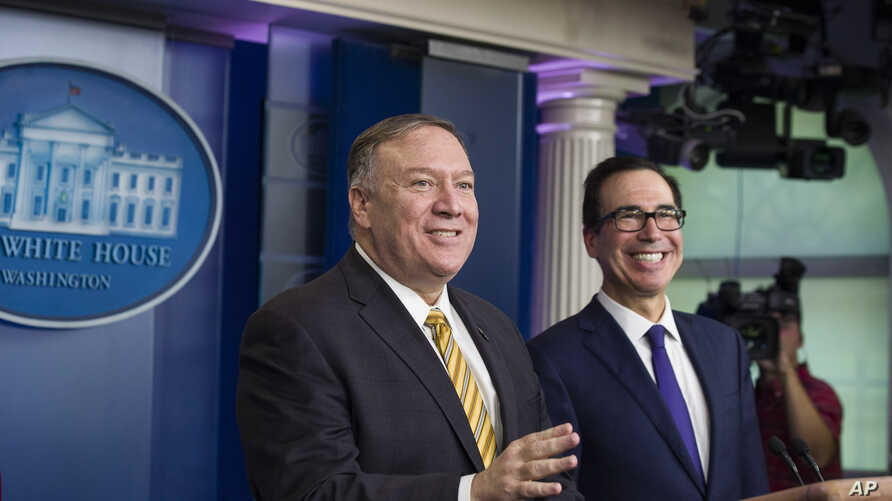 Secretary of State Mike Pompeo and Treasury Secretary Steve Mnuchin laugh as they speak with reporters in the White House, Sept. 10, 2019, in Washington. National Security Adviser John Bolton was to have attended the meeting.