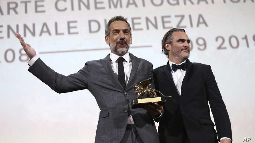 Director Todd Phillips, left, holds the Golden Lion for Best Film for 'Joker', joined by lead actor Joaquin Phoenix at the closing ceremony of the 76th edition of the Venice Film Festival, Venice, Italy, Saturday, Sept. 7, 2019. (Photo by Joel C…