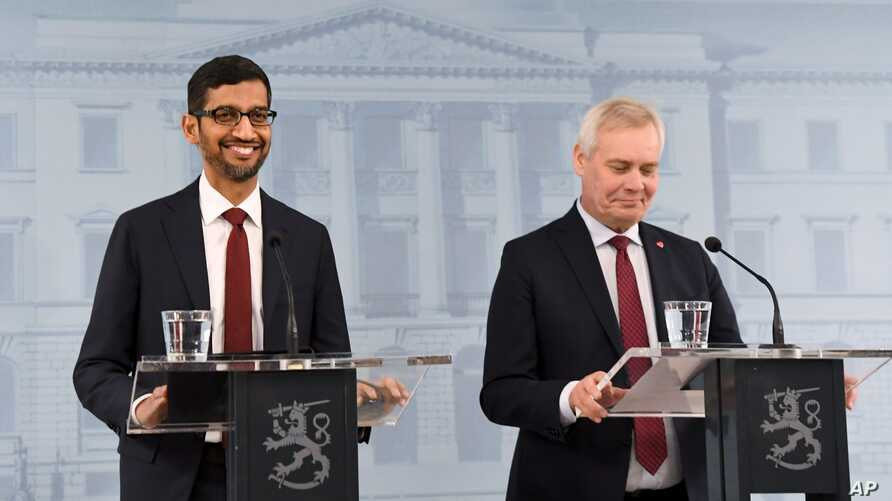 Finland Prime Minister Antti Rinne, right, and Google CEO Sundar Pichai take part in a joint press conference in Helsinki, Finland, Friday Sept. 20, 2019. (Jussi Nukari/Lehtikuva via AP)