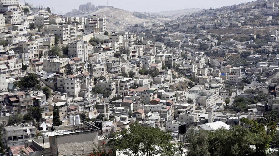 This Monday, Sept. 9, 2019 photo, shows a view of the east Jerusalem neighborhood of Silwan. New official data obtained by The Associated Press shows a spike in Jewish settlement construction in Israeli-annexed east Jerusalem since President Donald…