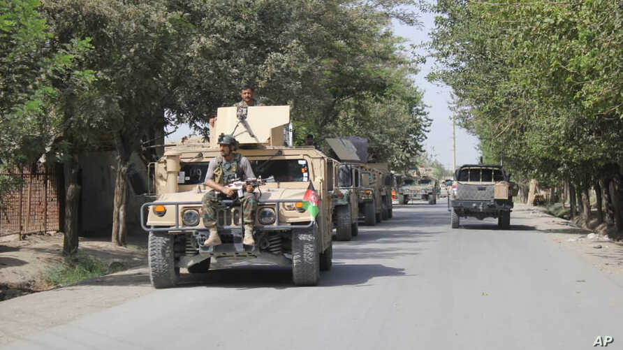 Afghan security forces arrive during a fight against Taliban fighters in Kunduz province north of Kabul, Afghanistan, Saturday, Aug. 31, 2019. The Taliban have launched a new large-scale attack on one of Afghanistan's main cities, Kunduz, and taken…