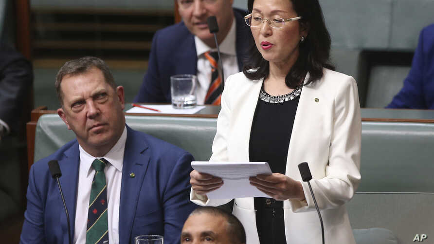 In this July 25, 2019, photo, Gladys Liu, the first Chinese-born lawmaker to be elected to Australia's Parliament, addresses the House of Representatives in Canberra, Australia.