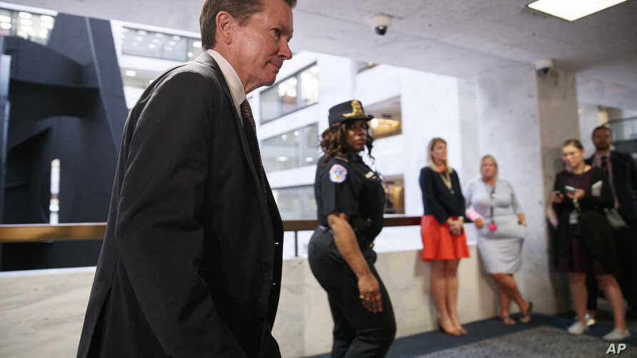 National intelligence inspector general Michael Atkinson, left, leaves a closed intelligence briefing, Thursday Sept. 26, 2019, on Capitol Hill in Washington. (AP Photo/Jacquelyn Martin)