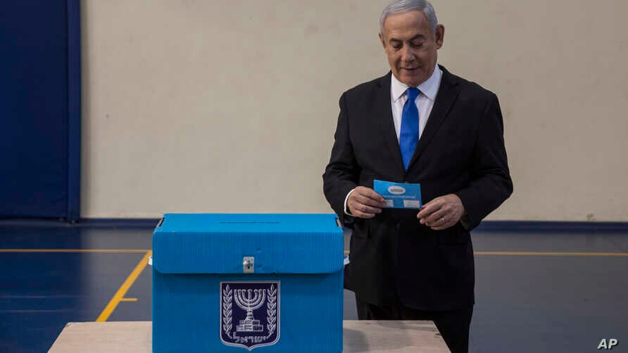 Israeli Prime Minister Benjamin prepares to vote at a voting station in Jerusalem on September 17, 2019.