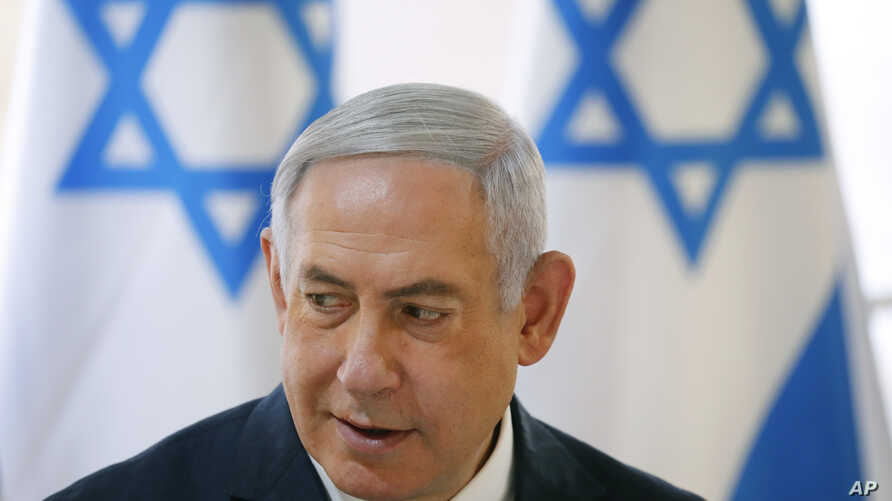 Israeli Prime Minister Benjamin Netanyahu chairs during the weekly cabinet meeting being held in the Jordan Valley, in the Israeli-occupied West Bank, Sunday, Sept. 15, 2019. Netanyahu convened his final pre-election cabinet meeting in a part of the…