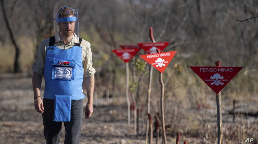 Britain's Prince Harry walks through a minefield in Dirico, Angola Friday Sept. 27, 2019, during a visit to see the work of landmine clearance charity the Halo Trust, on day five of the royal tour of Africa. Prince Harry is following in the…