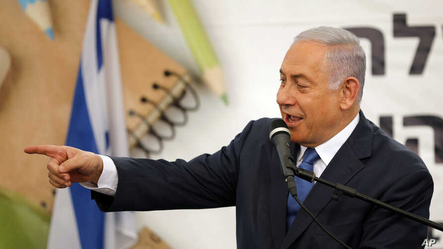Israeli Prime Minister Benjamin Netanyahu gestures as he speaks during a ceremony opening the school year in the settlement of Elkana Sunday, Sept. 1, 2019. Netanyahu is reaffirming his pledge to impose Israeli sovereignty on West Bank settlements. …