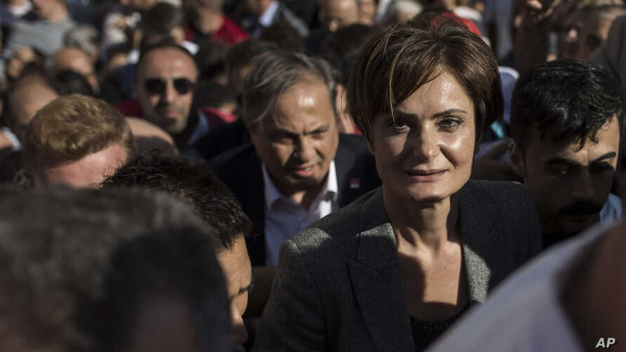 Canan Kaftancioglu, the head of Turkey's secular Republican People's Party in Istanbul, leaves the courthouse after her trial in Istanbul, Friday, Sept. 6, 2019. Turkey's state-run news agency says a court has sentenced the leader of the Istanbul…