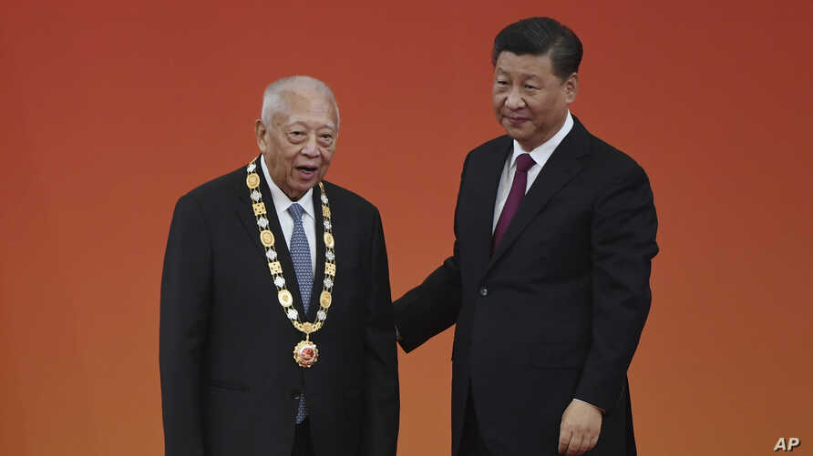 Former Hong Kong Chief Executive Tung Chee-hwa, left, stands with Chinese President Xi Jinping after receiving an award at a ceremony in Beijing's Great Hall of the People Sunday, Sept. 29, 2019. Chinese President Xi Jinping awarded medals and…