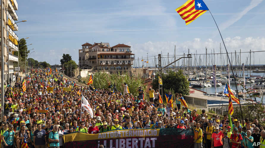 Catalan pro-independence demonstrators march as they arrive at Arenys de Mar, near Girona, Spain, Thursday, Oct. 17, 2019…