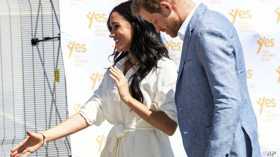 Britain's Prince Harry and Meghan, Duchess of Sussex visit a Youth Employment Services Hub in Makhulong, Tembisa, a township near Johannesburg, South Africa, Wednesday Oct. 2, 2019. The royal couple are on the last of their 10 day Africa tour. (AP…