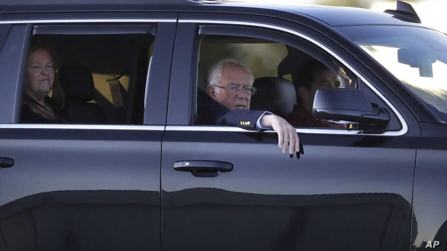 Democratic presidential candidate Sen. Bernie Sanders, I-Vt., right, and his wife, Jane O'Meara Sanders, left, depart…