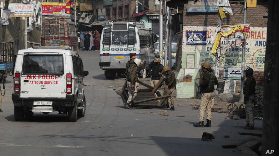 Indian policemen remove road blocks put up by protesters in Srinagar, Indian controlled Kashmir, Tuesday, Oct. 29, 2019. A…