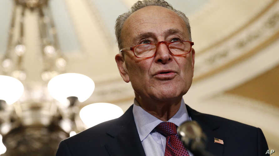 In this Oct. 22, 2019, photo, Senate Minority Leader Sen. Chuck Schumer of N.Y., speaks to members of the media following a…
