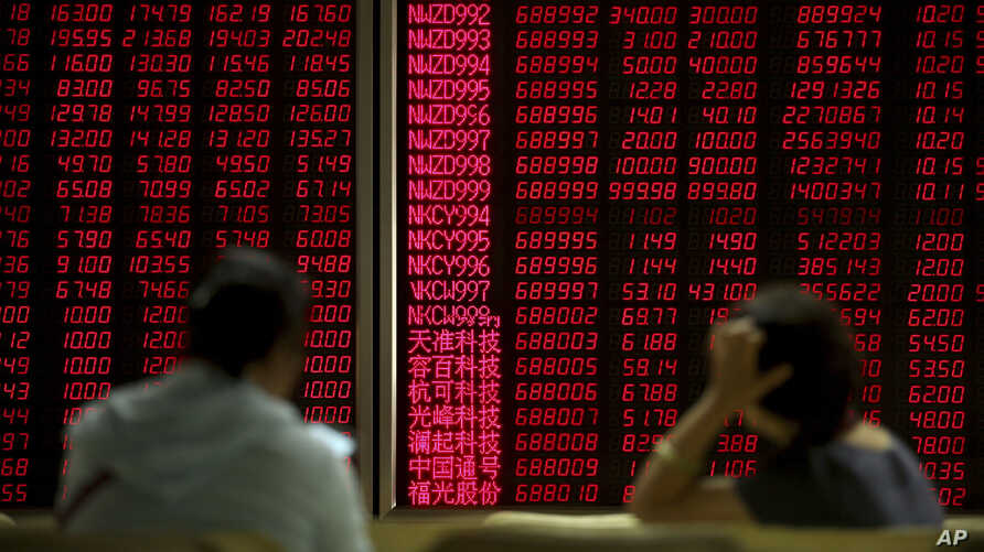 Chinese investors monitor stock prices at a brokerage house in Beijing, Friday, Aug. 2, 2019. U.S. Secretary of State Mike Pompeo on Friday hit out at China for predatory trade practices and human rights abuses that harm economic development. (AP…