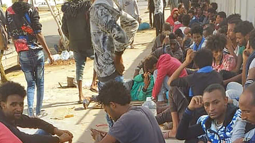 Hundreds of migrants who fled a detention center in coastal Libya crowd around a U.N. facility in Tripoli, Libya, Wednesday,…
