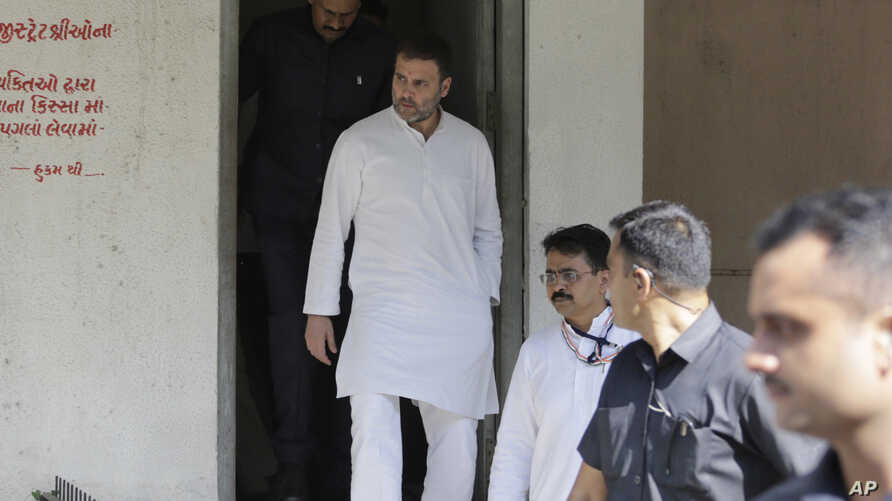India's opposition Congress party leader Rahul Gandhi leaves a court in Ahmadabad, India, Friday, Oct. 11, 2019. Gandhi…